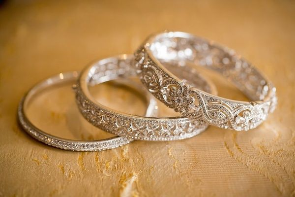 Bride's Sparkling Bangle Bracelets Photography: Danette Pascarella Photography Read More: http://www.insideweddings.com/weddings/catholic-ceremony-estate-reception-with-travel-themed-details/696/