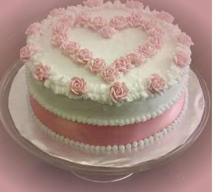 Round white valentine cake with light pink cake decor, or little girls b'day