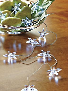 Make a big impact in a small space with a Battery Powered Star Garland | Solutions.com #Garland #Lights #Holidays #SmallSpace #Decorations