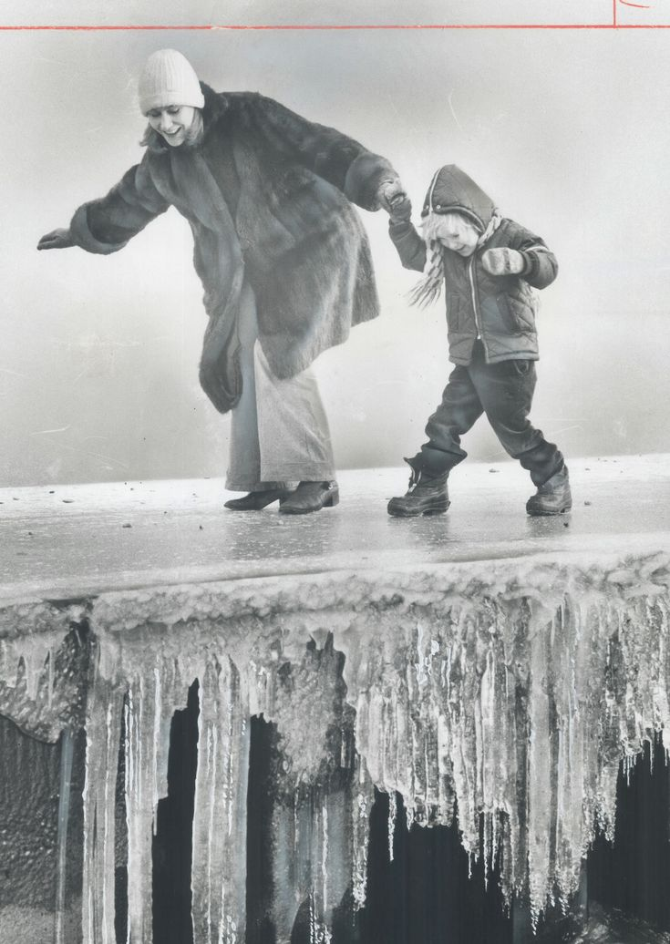 Our on-again off-again winter is keeping us on our toes, the weather changing from spring-like warmth back to the deep freeze, in an afternoon! This mother and child are tackling similar conditions on Balmy Beach in the winter of 1975. In this picture, the icicle fringes are flash-frozen spray from lake Ontario. Remember to be nice and clear your ice -- your neighbours are depending on you! Courtesy: Toronto Star Photo Archives
