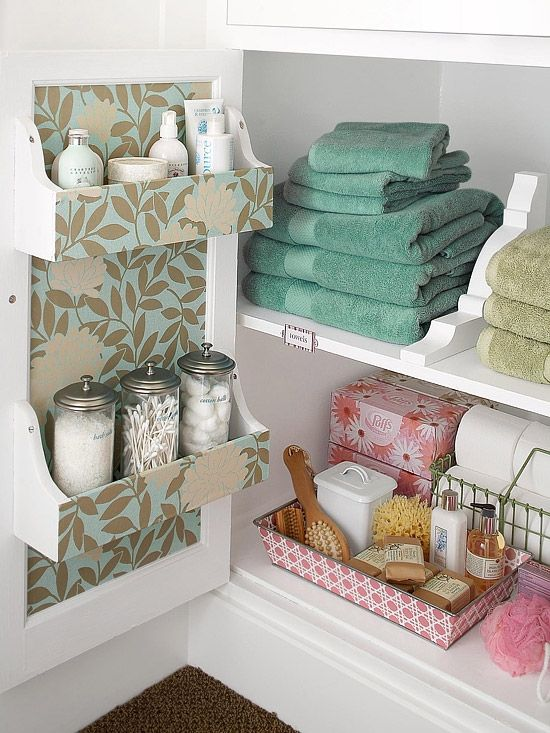 To make my guests feel welcome, in the guest bathroom is everything they might possibly need. And what better way to organize it than in this DIY paper-accented shelving on the inside of the door and these brackets as shelf dividers. So cute and unexpected. I love being a great hostess!  - TOTALLY stealing this idea.
