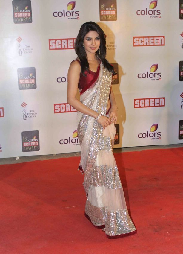Priyanka Chopra spotted Dressed up in Indian trendy Saree. Draped in a silver and white sari and a rich contrasting blouse making a strong style statement with amazing embroidery stuff.