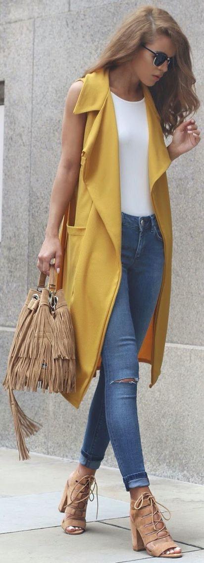 Yellow vest, fringe bag, & lace up heels.