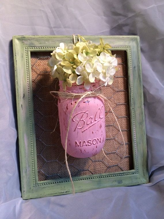 Add vintage Shab with this Mason jar, distressed, metal framed vase, with burlap and chicken wire attached and ready to hang.  Mason is not painted