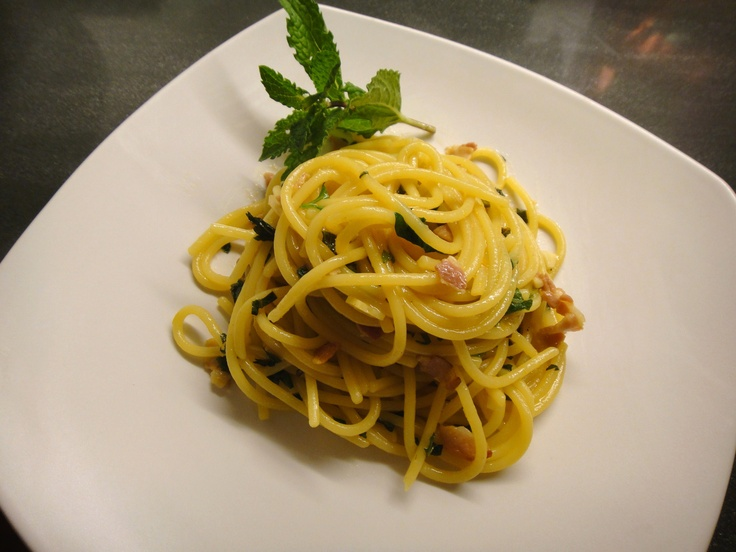 Spaghetti Milanese - OMG! :)  Nothing like pasta cooked in saffron broth, with pancetta, garlic, orange zest, white wine, butter, parmigiano-reggiano cheese, fresh italian parsley and fresh mint!