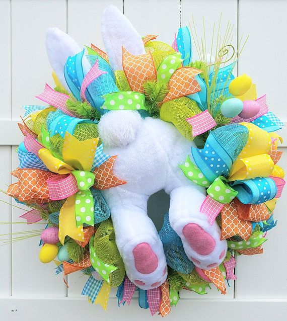 This Easter wreath is in stock and ready to ship! Its a dreary day outside today (as you may notice from the photos), but the colors on this wreath will brighten any day! This Easter wreath features the cutest white bunny butt, legs, and ears. All the Easter colors are