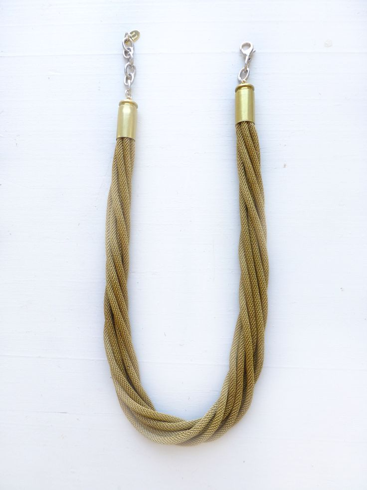Broad Street Jewelry - Multi chains of brass mesh snake chain are layered
