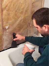 how to lay tile in a tub surround- instructions from start to finish.