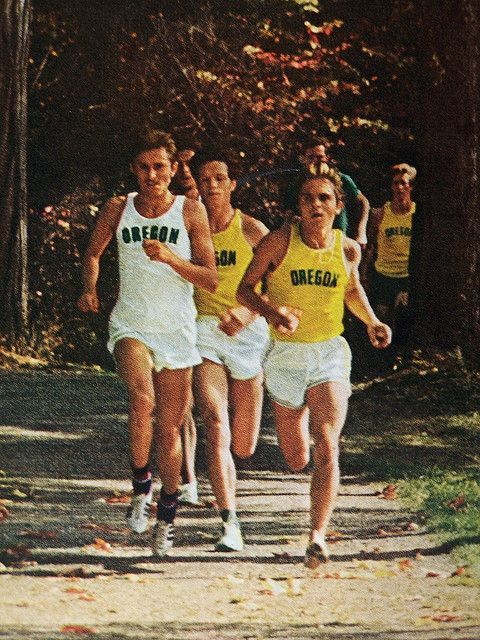 Sophomore Steve Prefontaine leads his Oregon track teammates out of the firs in a training run at Shadow Hills County Club golf course near Junction City, Oregon, just north of Eugene. This photo appeared in Sports Illustrated, Nov 1, 1971.