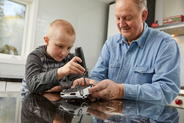 using cool tools, fixing toys with Grandpa.  www.screwcancer.today/ #screwcancer #greatgiftideas #cooltool #fixingtoys #grandpa #toysandtools #fathersday #theperfectgift