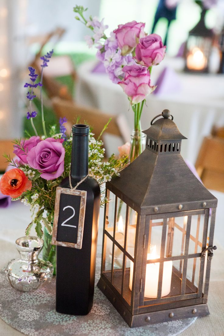 Lantern and chalkboard wine bottle centerpieces just in for Wedding table decorations with wine bottles