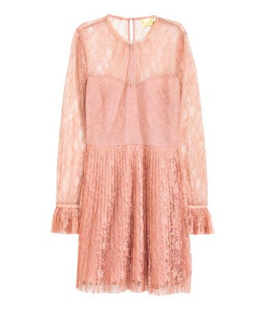 Powder pink. Lace dress with an opening at front and small opening at back with button at back of neck. Long sleeves with a pleated flounce at cuffs, seam