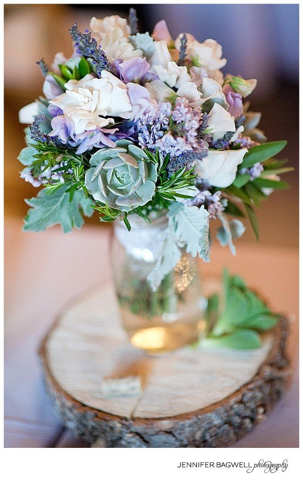 Lavender and Succulent bouquet on a rustic wood round. | by Gavita Flora. #wedding #flowers
