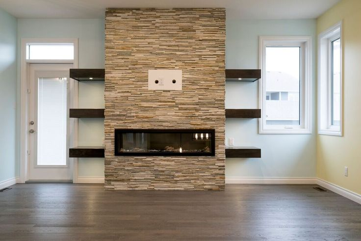 We love the stone and floating shelves around this ribbon fireplace #stunning #harmonyhome
