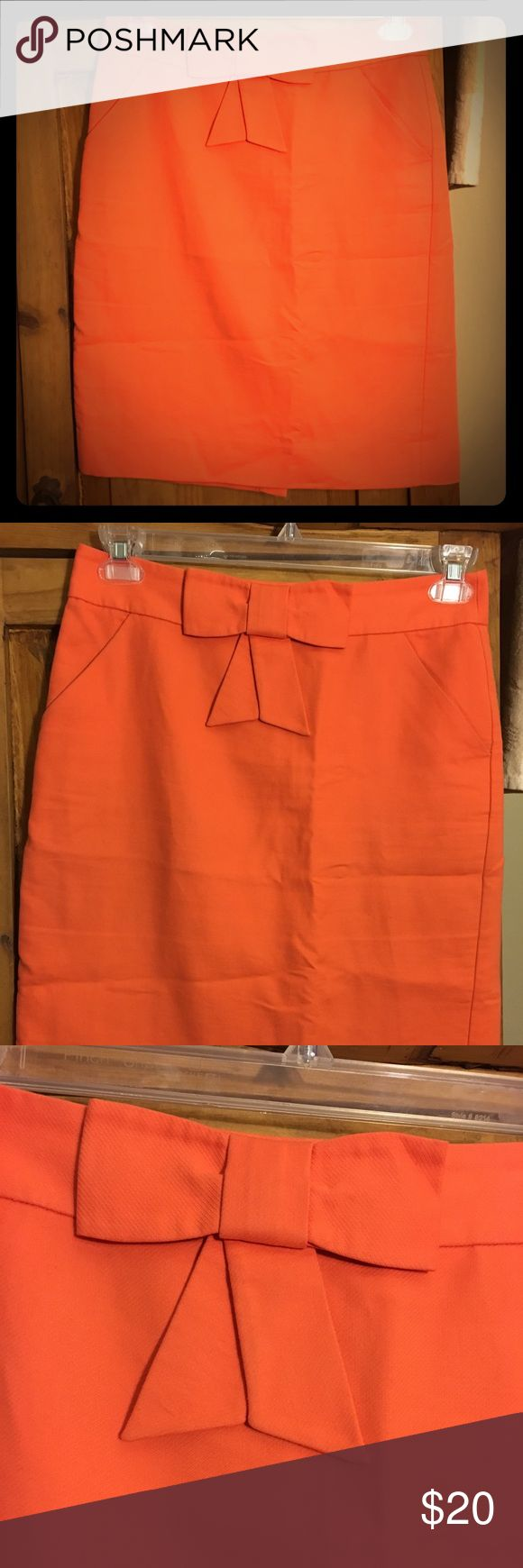 J. CREW salmon pink orange pencil skirt pinup 4 Super cute. Vintage inspired 1950s look. Bow on the front. Beautiful pink orange salmon color. Pencil skirt size 4 J. Crew Skirts Pencil