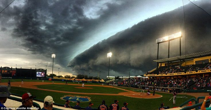 An apocalyptic-looking storm rolled overChampion Stadium inKissimmee, Florida, on Friday during a game between theAtlanta Braves and Houston Astros before unleashing a torrential downpour