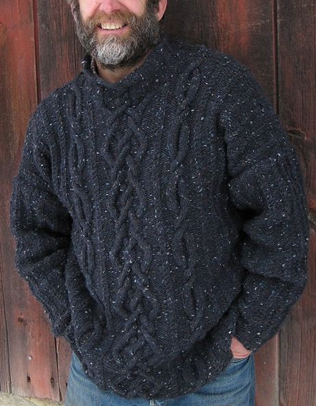 "Free Knitting Pattern for Rhapsody in Tweed Pullover - This long-sleeved men's sweater by Kathy Zimmerman features wide and narrow open cables with mini-cable ribs against a reverse stockinette-stitch background. Finished Size: 40 (44, 48, 52, 56)"" (101.5 [112, 122, 132, 142] cm) bust/chest circumference. Pictured project by Mango"
