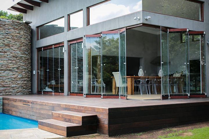 Frameless Stacking  Doors are no doubt the biggest trend when building or renovating in 2014 ! Look at our stunning new improved Frameless Stacking Door, now with Aluminium bottom track !   Available from all our branches   Kya Sand 011 708 2488  Krugersdorp 011 664 7192  Pretoria (Montana) 012 548 7672  Hartbeespoortdam 012 244 1319  Rustenburg 014 596 6353  Klerksdorp 018 462 0784