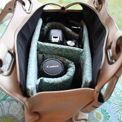 This tutorial shows you how to make a camera bag out of purse instead of having to carry around and ugly camera bag!