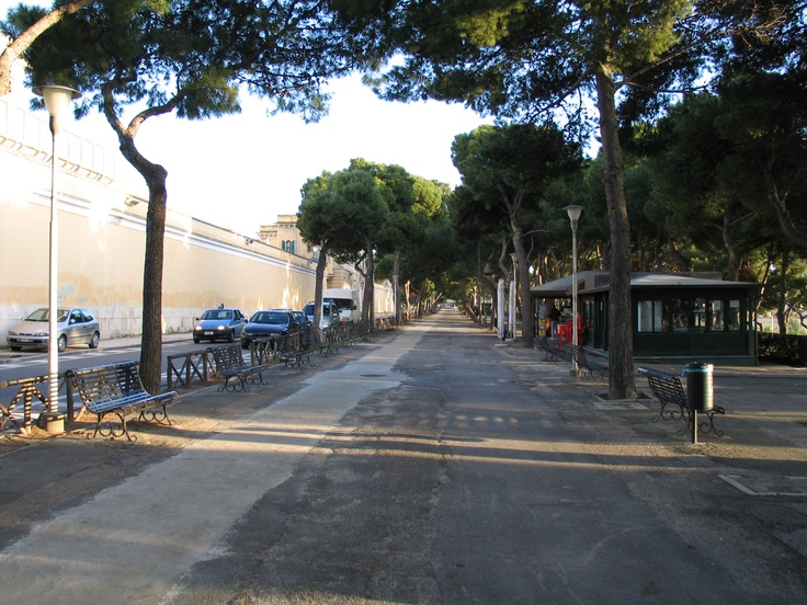 Walking along Viale Buoncammino - prison wall to the left