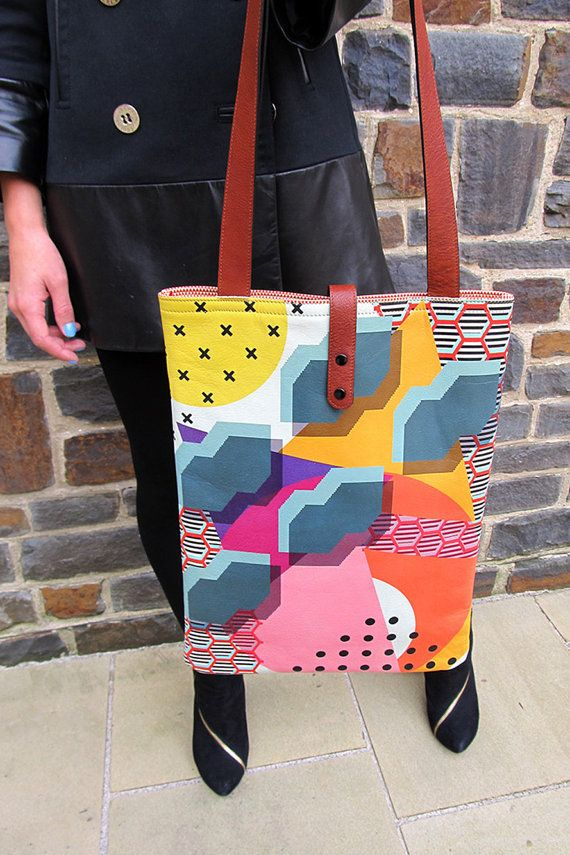 A beautiful and practical bag for everyday use.  Printed on high quality, durable leather with a soft, cognac lining. The straps are made of buffalo