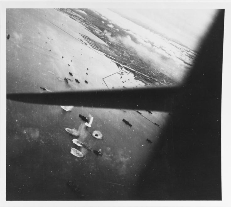 """lex-for-lexington: """"""""Japanese shipping under attack off the port of Manila, Luzon, on 21 September 1944. Photographed from a USS Hornet (CV-12) plane. Bow of tanker in lower center appears to have been hit, or narrowly near-missed by a bomb."""" (NHHC:..."""