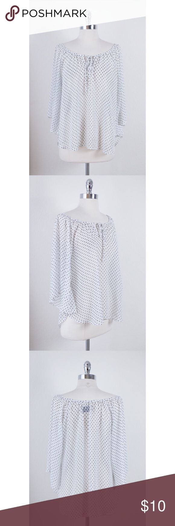 White and Black Polka Dot Print Batwing Dolman Top This is an adorable white and black polka dot blouse featuring a round neck and batwing dolman sleeves. Front tie closure. Well loved but in great shape! 100% Polyester. Hand wash cold. Made in USA. Tops Blouses