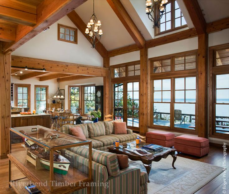 Large Windows Face The Lake In This Waterfront Timber Frame Home.