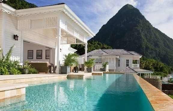 The Sugar Beach a Viceroy Resort (formerly Jalousie Plantation) offers a choice of superior private villa accommodations, with a white beach frontage and great views across the sea on one of the most attractive Caribbean islands.  http://www.etraveltrips.com/sugar-beach-a-viceroy-resort-st-lucia/