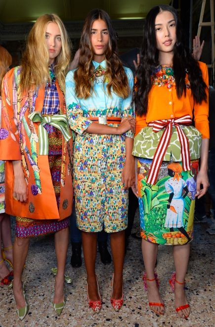 Models backstage in vibrant colours and fabulous prints.