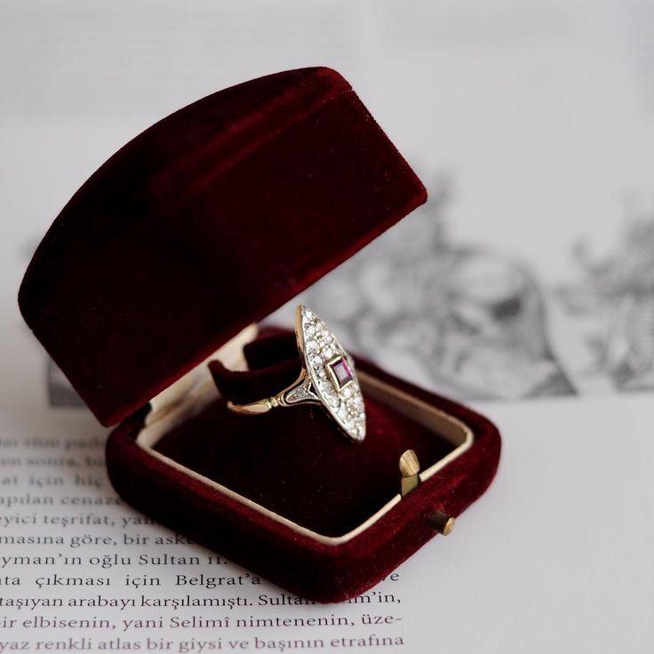 An Antique navette shaped Ruby and Diamond Ring. The delicate ring is centering with square cut  Ruby surrounded by ,85 carat old cut diamonds.Available now in our antique jewelry collection   Merkezindeki kare kesim Yakut ve onu çevreyelen ,85 karat old cut Elmas'la bezeli mekik formlu zarif yüzük .Antika mücevher koleksiyonumuzda bulabilirsiniz .    #ozerartantiques  #istanbul  #bosphorus #love #diamond  #handcraftedjewelry #instafashion  #antiquejewelry  #purity #ring