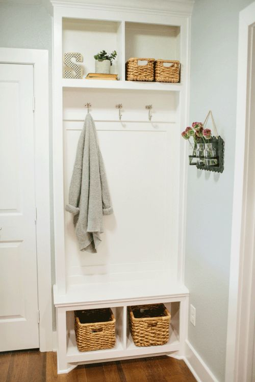 The laundry room was cut in half in order to create more space for a shower in the master bathroom. In the new mudroom, Chip and Jo added a small custom cabinet for storage. Joanna also designed a corner space for backpacks and shoes, in hopes of helping the clients stay organized in this tight space.