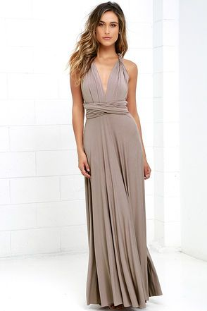 "As Seen On Nicholl of The Chiffon Diary blog! Versatility at its finest, the Tricks of the Trade Taupe Maxi Dress knows a trick or two... or four! Two, 73"" long lengths of fabric sprout from an elastic waistband and wrap into a multitude of bodice styles including halter, one-shoulder, cross-front, strapless, and more. Stretchy, latte brown jersey knit hugs your curves as you discover new ways to play with this fascinating frock. Full, maxi-length skirt has a raw hemline. Want Styling Tips?…"