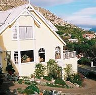 CLOVELLY FAIRWAYS GUEST HOUSE & B&B, Clovelly, Cape Town - Overlooking Clovelly Golf Course and bordering on a nature reserve the Guest House has 6 charming fully en suite double/twin rooms with spectacular views over sea, valley and mountain.