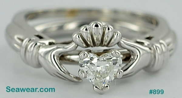 Claddagh wedding ring enhancer (with small solitaire) maybe?? It's ehh. Very last last last choice.