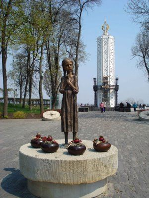"""The new monument to victims of Stalin's hunger campaign known as the Holodomor of 1932-1933 when people were shot for saving even a handfull of grain. This genocide was justified as an attempt to move the Soviet Union into an urban and industrialied power (by transferring more food to the cities) but it also was deliberately targeted at the Ukrainian countryside and many believe it was an attempt to break a strong Ukrainian national consciousness."""