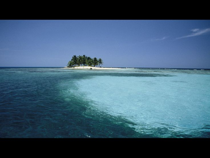 One of the Silk Cayes – tiny, serene, white-sand islands on the Belize Barrier Reef.