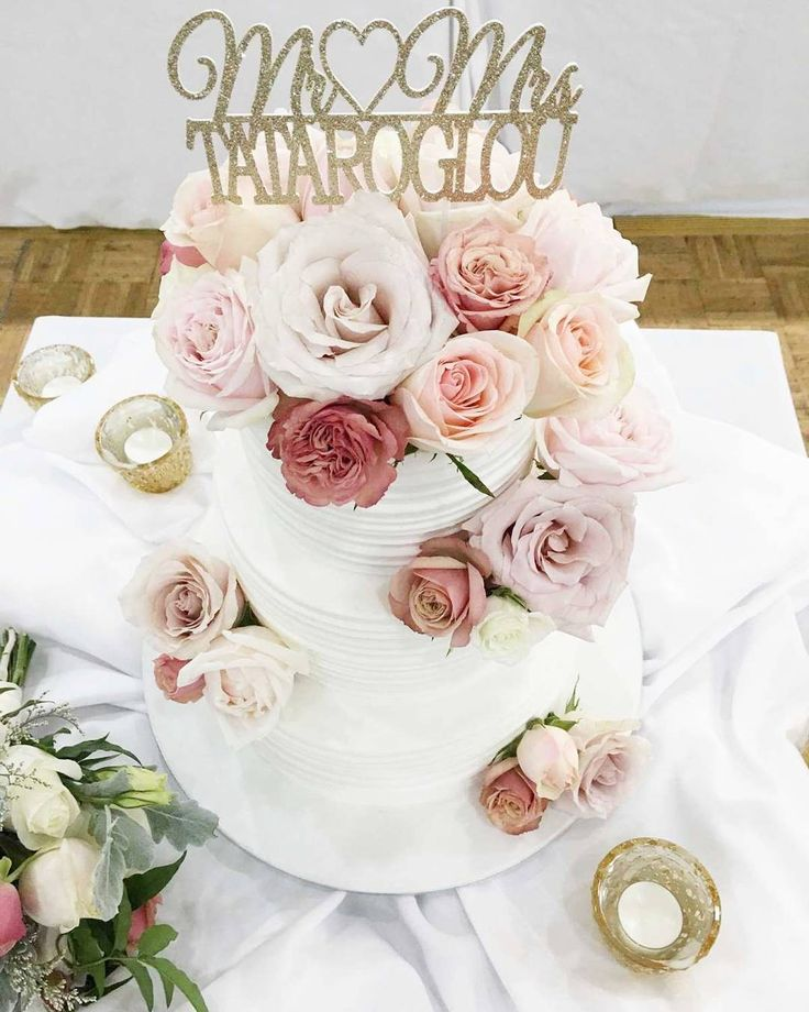 wedding cake with blush pink and pastel flowers