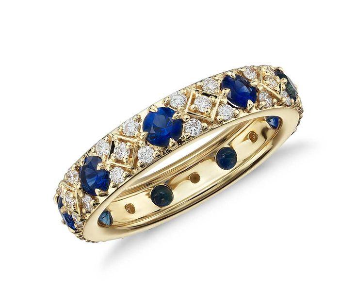 Vibrant blue sapphires and pavé-set diamonds create a brilliant, eye-catching wedding band.