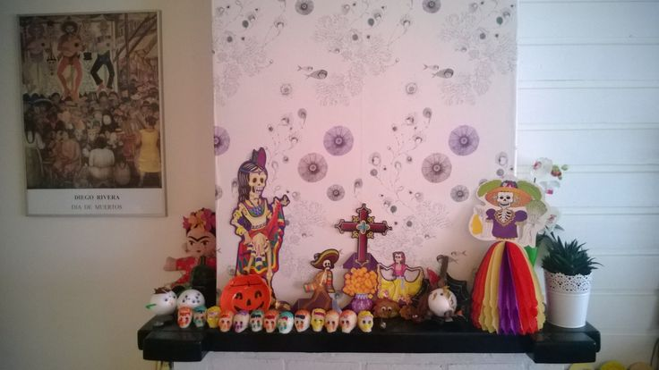Dia de los muertos altar in my Dutch living room. The children and I've added a touch of autumn and samhain as well to commemorate Halloween. Next to that it's also directed to Frida Kahlo and her 'panson', Diego Rivera.