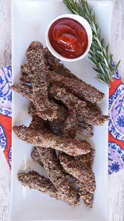Kick your chicken strips up a notch with almond flax and spicy ketchup.
