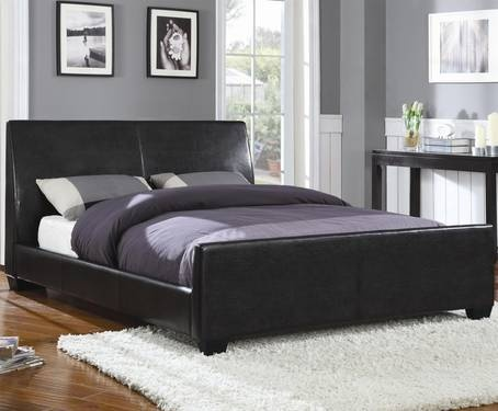 Black bed frame. Sleigh bed style with a low foot board.