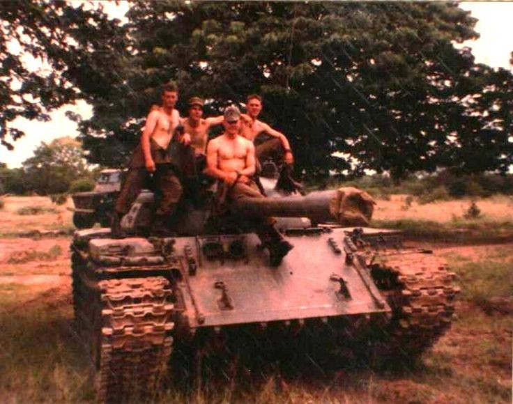 SADF soldiers by captured T-55 from Angolan Forces.