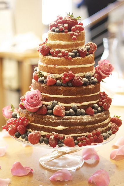 "A ""naked"" cake is a beautiful take on a traditional wedding cake, but with an added vintage, rustic feeling (plus gorgeous fresh flowers and fruit!)"