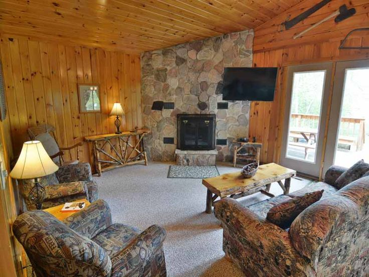 Enjoy convenient one floor living on your next Northwoods getaway at Spruce Cottage. This comfortable 3 bedroom/1 bath, cedar-sided cottage has a large, wrap around deck with a handicap accessible ramp and plenty of outside bench seating. There is a picnic table, BBQ charcoal grill and large, level yard leading down to a private pier and 150 feet of frontage on the Namakagon River with easy access to the lake itself.