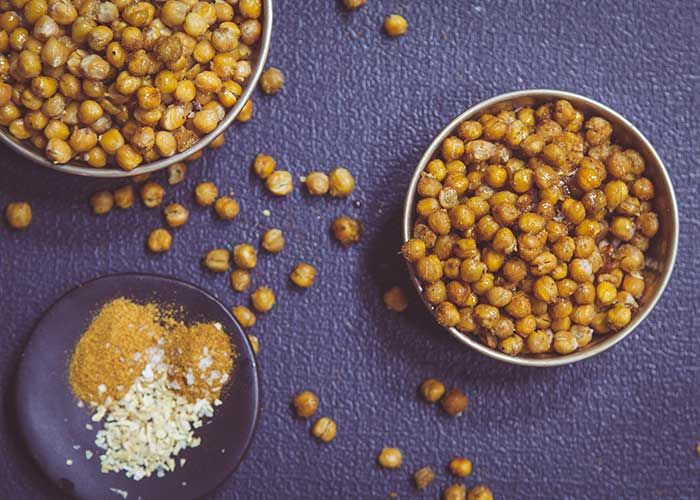 If you're looking for a gluten free, sugar free and vegan snack, look no further than this Spicy Roasted Chickpeas recipe!