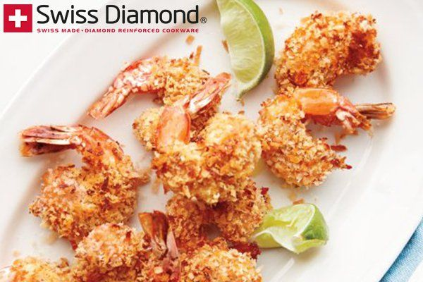 """BAKED COCONUT SHRIMP RECIPE: ~ From: """"Swiss Diamond.Com"""" ~ Recipe Courtesy Of: """"KATIE SARGEANT"""" ~ Posted: June 27, 2014. ~ Prep.Time: 10 min; Cooking Time: 20 min; Total Time: 30 min; Level: Easy; Yield: (4 servings). *** Take your taste buds on a tropical vacation with this lightened-up recipe for sweet and savory Coconut Shrimp."""