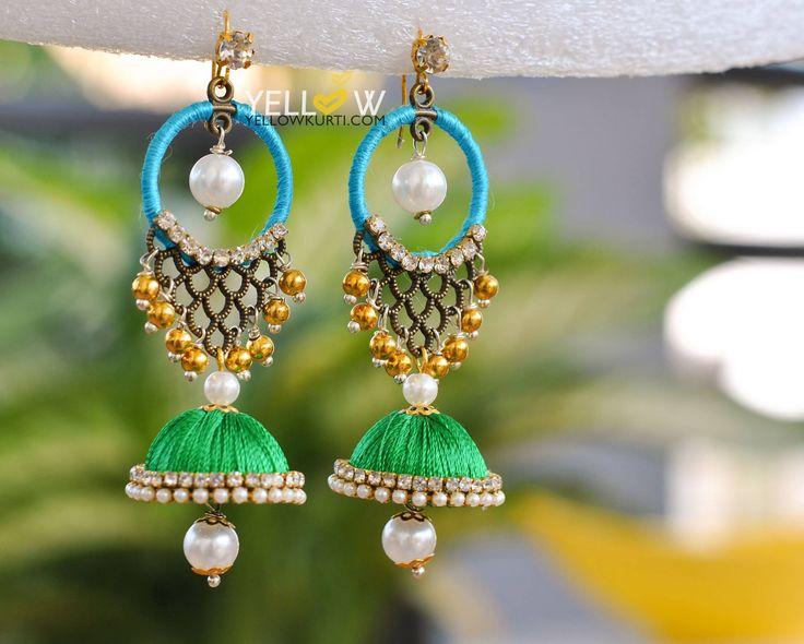 Exclusive Silk Thread Bali Jhumkas in vibrant color combination with pearls and beads.Price - 649 INR + Shipping Kindly write to us at teamyellow@yellowkurti.com or private message us here on Facebook for Orders ! 08 February 2017
