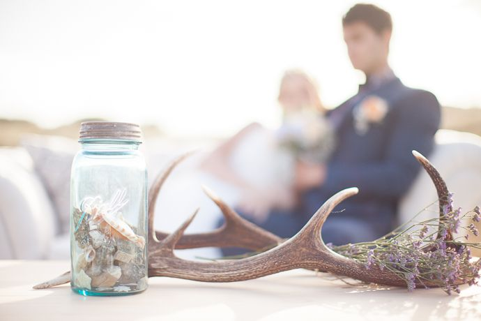 Mason Jar and antler table decor from a modern outdoor intimate lounge  | Featured on paperandlace.com | Vintage Furniture Hire | www.borrowandbeau.co.nz | Styling: Borrow and Beau | Photography: PoppyMoss Photography
