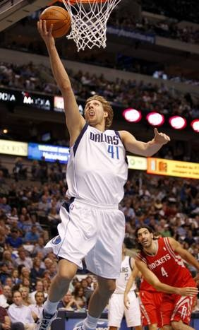 Dallas Mavericks power forward Dirk Nowitzki (41) goes up for a basket in the first half during NBA basketball action between the Dallas Mavericks and the Houston Rockets at the American Airlines Center on Wednesday, April 18, 2012.